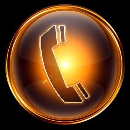 phone icon gold, isolated on black background. photo