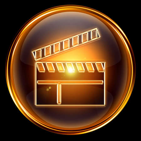 movie clapper board icon golden, isolated on black background.
