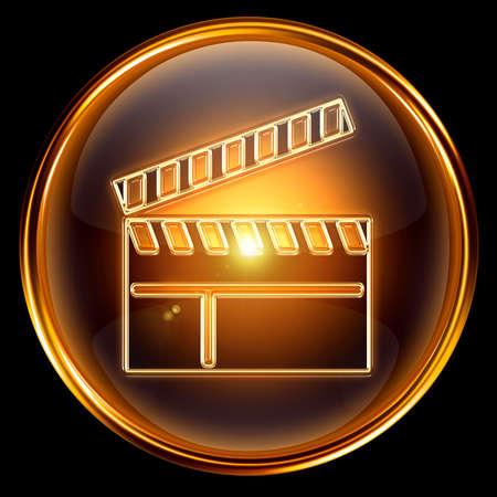 movie sign: pel�cula clapper Junta icono oro, aislado sobre fondo negro. Foto de archivo