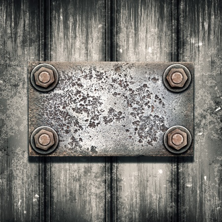 Old metal plate on metallic wall photo