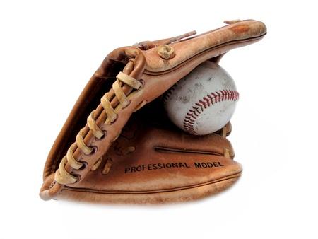 Old baseball mitt with baseball isolated on white.