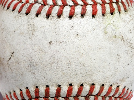 Macro image of a used baseball.
