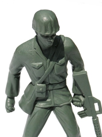Close-up action toy soldier, isolated on white. Stock Photo - 10269848