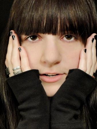Close-up face portrait with hands.