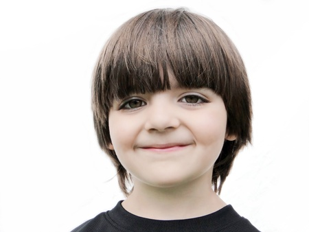 Adorable smiling little boy isolated on white background.