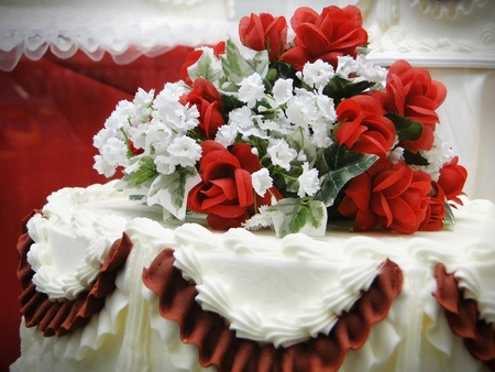 Wedding cake with a floral arangement on top. Stock Photo