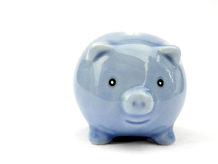 Little blue piggy bank isolated on white.