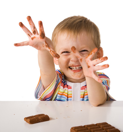 dirty man: The child shows the hands smeared by chocolate Stock Photo