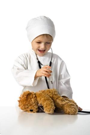 The child treats toy a bear photo