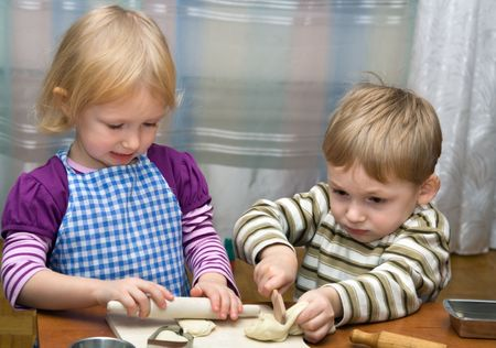 blind child: Small girl and boy help on kitchen