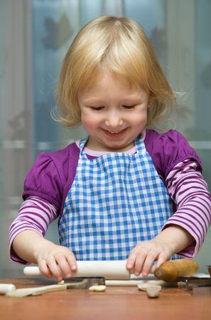 blind child: Little girl rolls the dough
