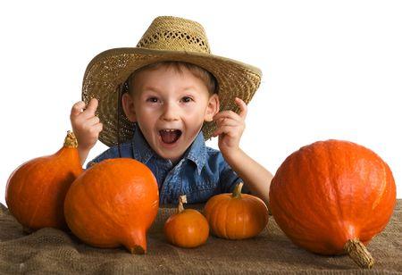 Small farmer with pumpkins photo