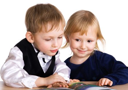 educating: Young girl and the boy read the book