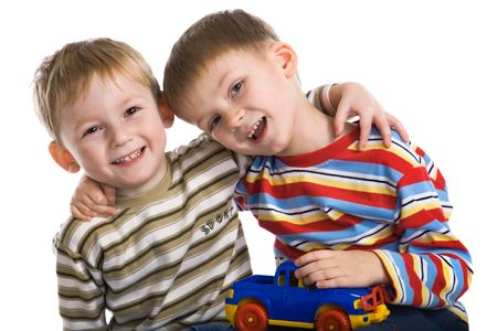 cheerfully: Two young boys cheerfully play Stock Photo