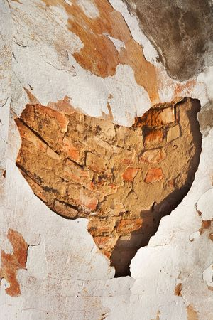 Fragment of old brick wall  photo