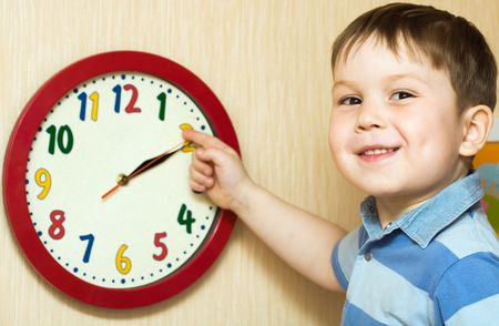 Small boy with clock photo