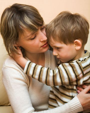 upset woman: Mother and son Stock Photo