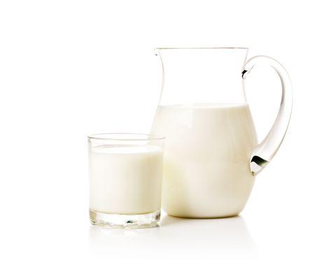 Milk jug and glass Stock Photo