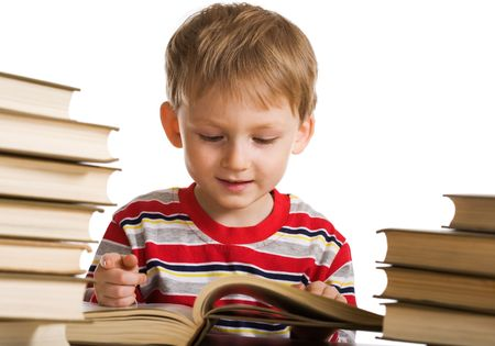 Happy young boy with books photo
