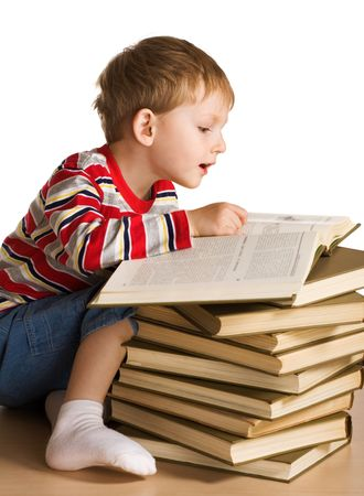 Kid with a pile of books Stock Photo - 3064532