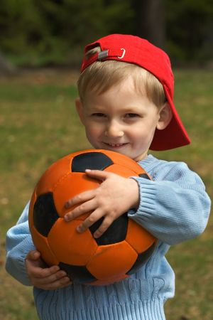 Happy kid with a ball Stock Photo - 3092645