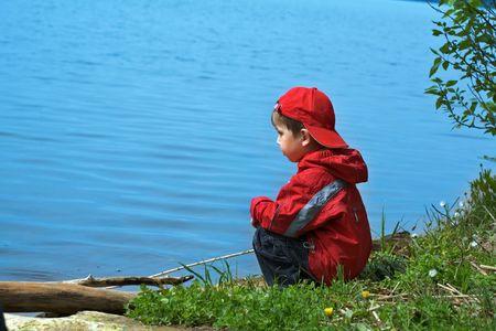 children pond: Small fisherman