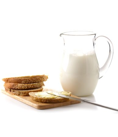 Bread and milk for breakfast photo