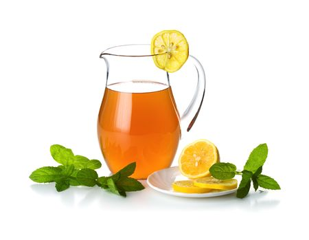 Jug with cold tea and lemon slices  photo