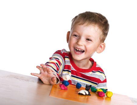 plasticine: Happy child with plasticine