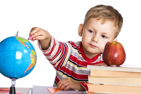 Young boy studies the globe