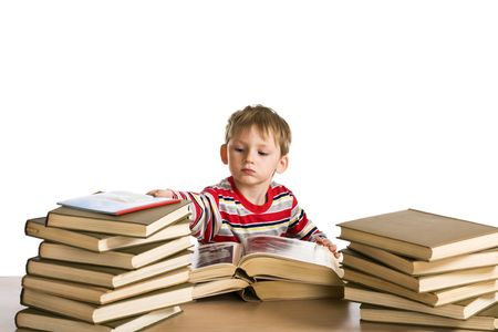 Young boy with a heap of books photo