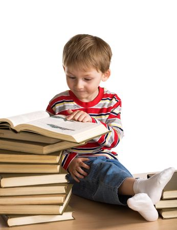 Little boy with a heap of books photo