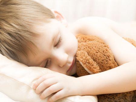 Sleeping little boy with a teddy bear Stock Photo - 3506084