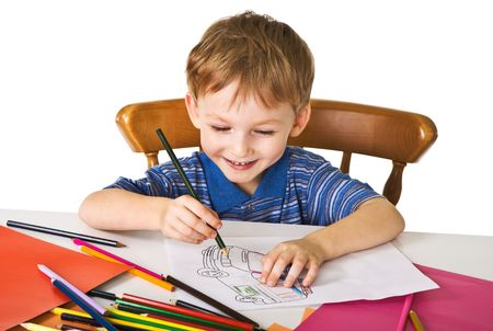 Young boy studies to draw Stock Photo