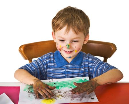 Young boy studies to draw photo
