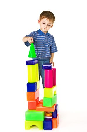 Child plays with color blocks