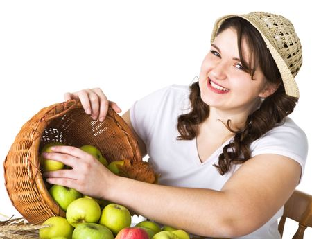 Pretty girl with basket of apples photo
