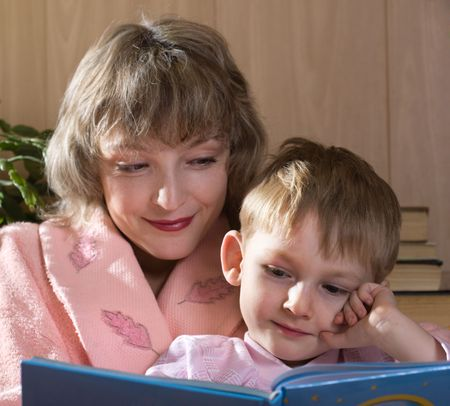 Mother and son read book   photo