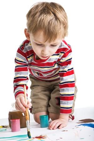 Little boy with paints photo