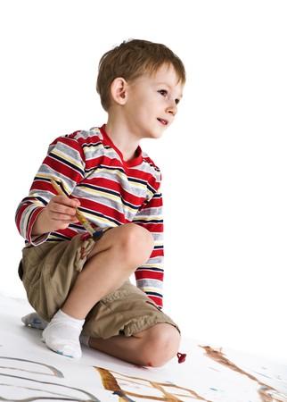 Little boy with paintbrush photo