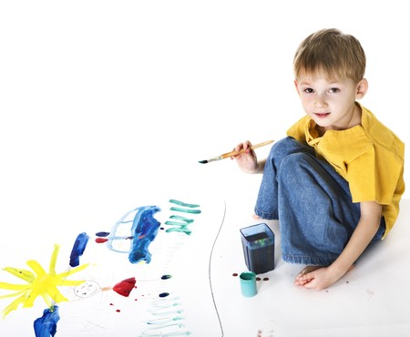 Little boy with paints