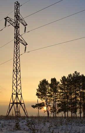 poling: Electric polingr against sunset sky Stock Photo