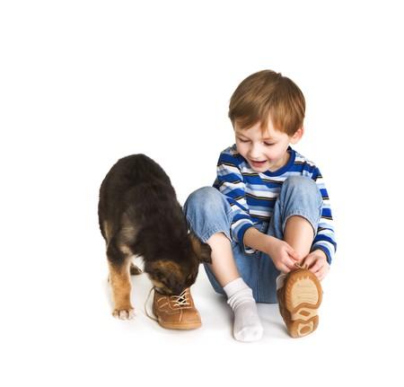 Ni�o y perro Foto de archivo