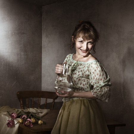 Vintage portrait of young woman with a jug photo