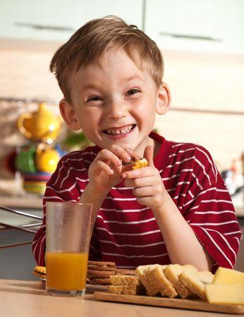 Child drinking orange juice Stock Photo - 4871465