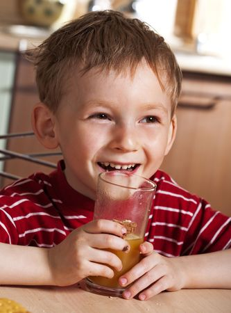 Child drinking orange juice Stock Photo - 4981180