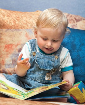 Baby boy with book Stock Photo
