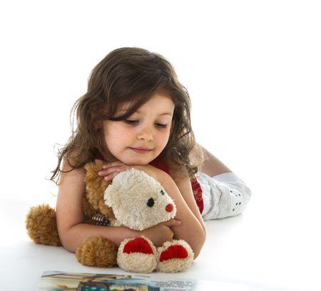 cute girl with teddy bear: Little girl with book Stock Photo