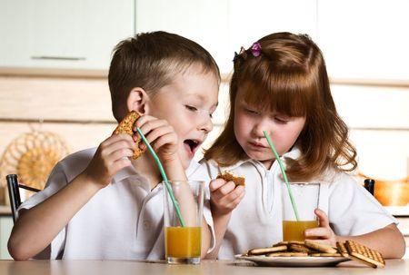 orange snake: Children drink juice