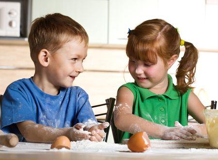 Little assistants on kitchen Stock Photo